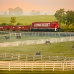 R. J. Corman locomotive pictured behind horse farm