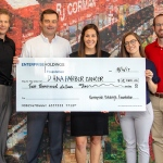 Enterprise Fleet Management visits R. J. Corman with $2,000 check