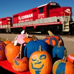 Painted pumpkins with an R J Corman train in the background